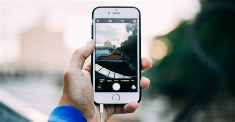 Person Holding Iphone 6 Outdoor · Free Stock Photo