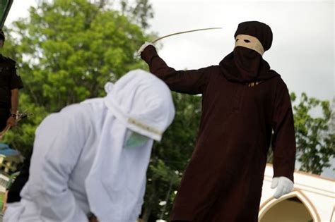 Indonesian woman whipped by masked Sharia law enforcer for