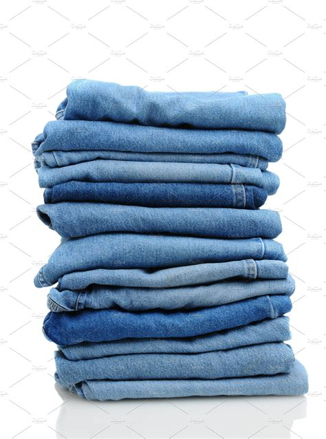 Stack of Blue Jeans on White ~ Beauty & Fashion Photos