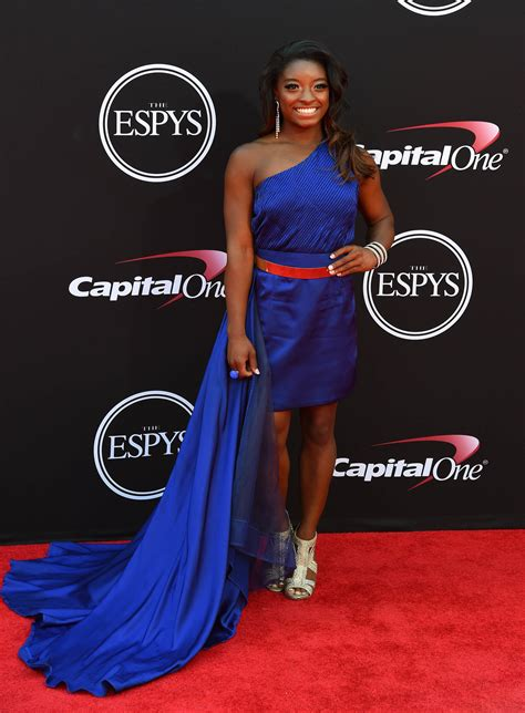 While walking the red carpet, Biles rocked a midnight blue
