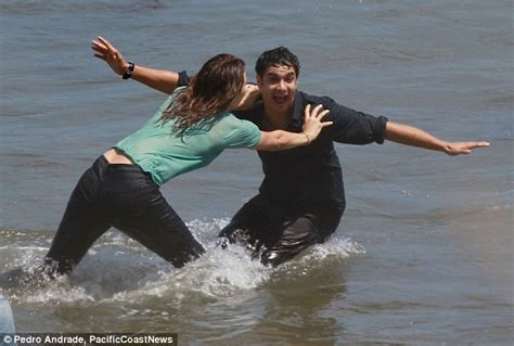 Katharine McPhee and Elyes Gabel kiss in the sea for